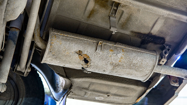hole in muffler symptoms